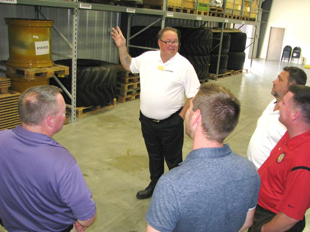 Winslow Robin Williams, Hydrema U.S. warehouse manager, leads a group on a tour of the new facility.