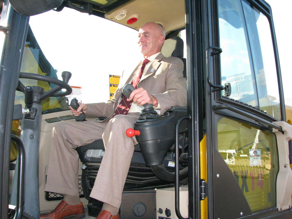 Larry Barfield, CEO of XPT2 and director of capture management of Honeywell Technology Solutions, Columbia, Md., operates a Hydrema MX14 excavator after his presentation, which included an endorsement of the Code of Support Foundation.