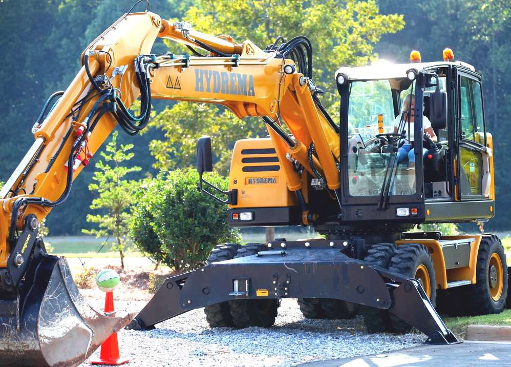 This guest operates a Hydrema wheeled excavator during the excavator skills competition.