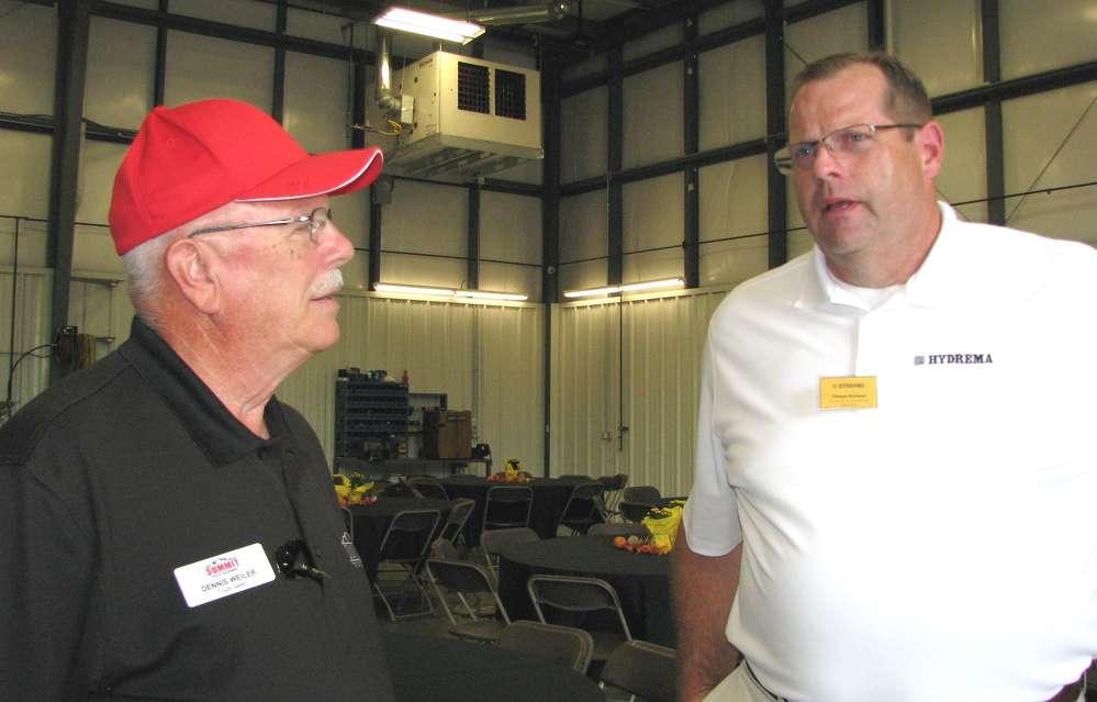 Dennis Weiler (L), Summit Truck Equipment, Wathena, Ky., and Thomas Hartman, Hydrema U.S., discuss the off-road truck market.