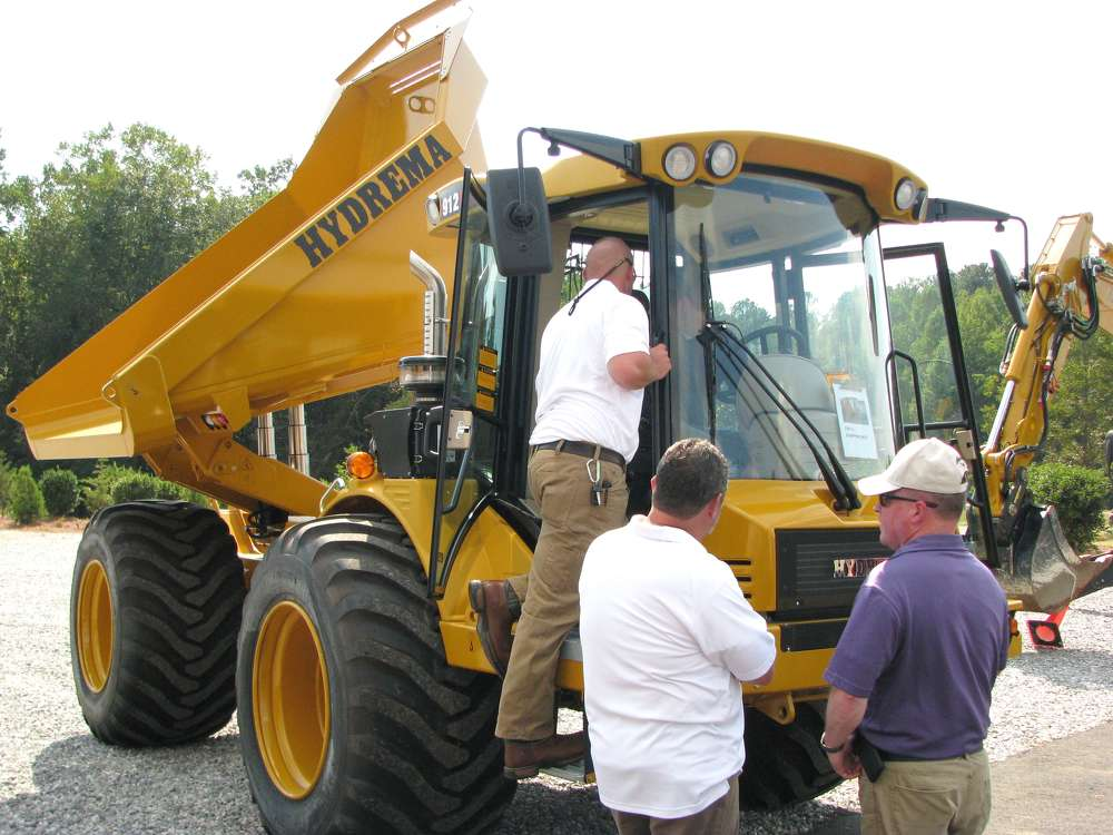Attendees take advantage of the opportunity to get a feel for the Hydrema 912HM off-road trucks.