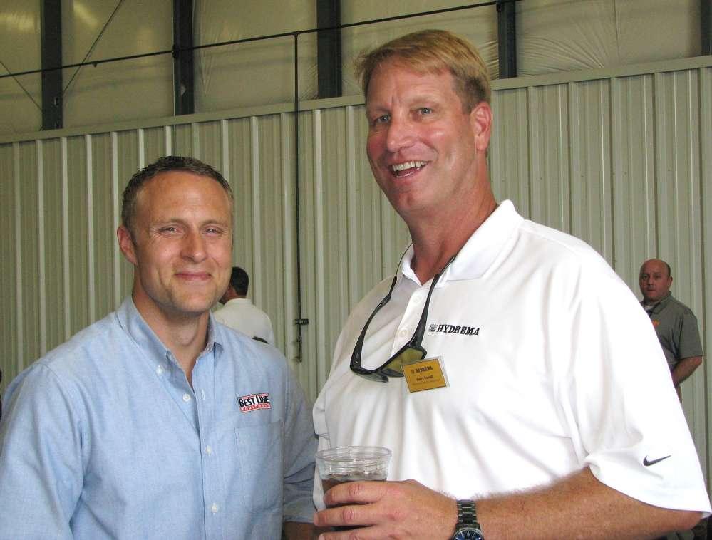 Adam Houseknecht (L), Best Line Equipment, State College, Pa., talks with Barry Ferrell, Hydrema manufacturer representative.