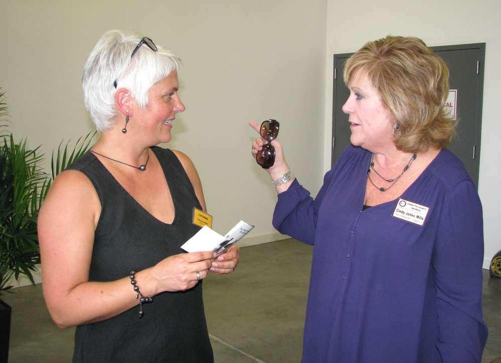 Jette Binder (L), Hydrema, talks with Cindy Jones Mills, Forsyth County, Ga., commissioner.