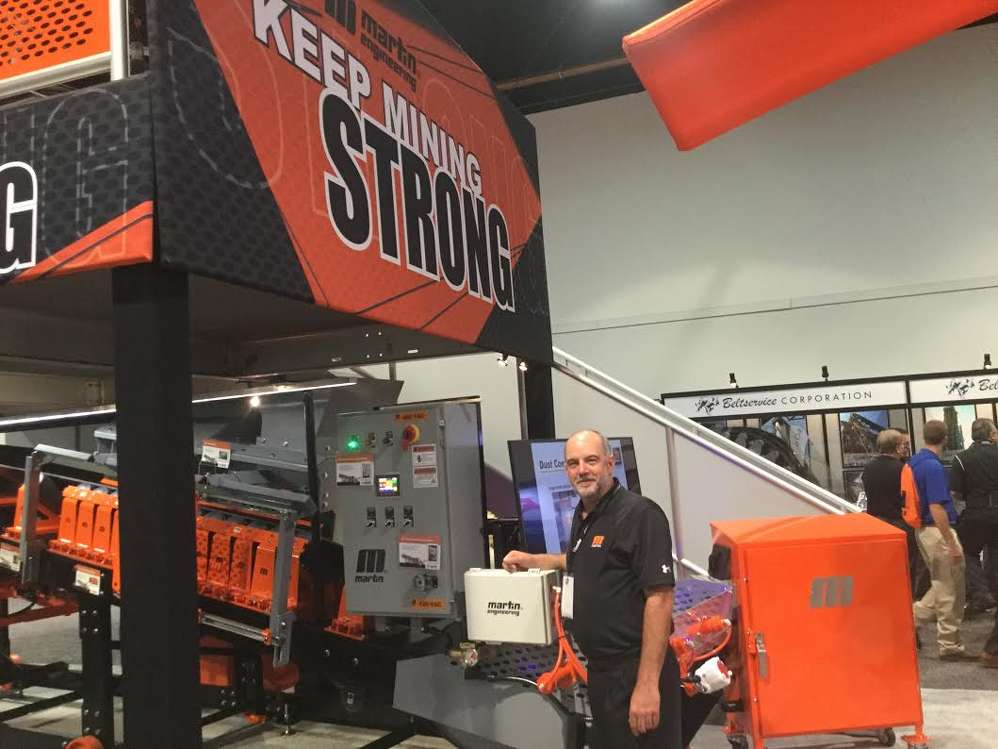 Mark Strebel, division manager of Martin Engineering, demonstrates the latest innovations in the handling of bulk materials cleanly and safely.