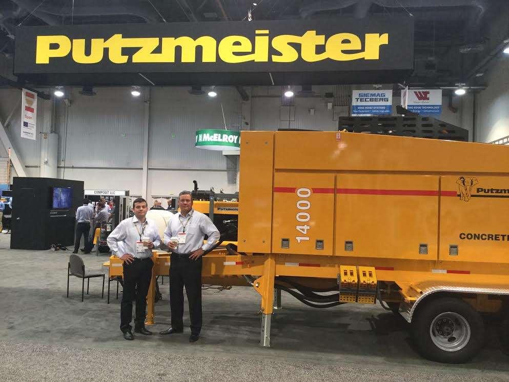 Putzmeister's Alejandro Monastrio (L), regional sales manager, and Marc Aguilar, VP of Latin America sales, present the company's 14000 concrete pump.