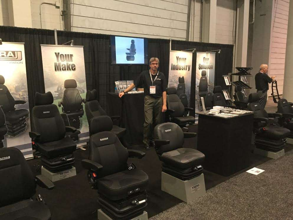 Warren Lafoy, sales manager of Ultra Seat Corporation, Edmonton Alberta, Canada, informs event goers that the company has been manufacturing industrial seating for more than 20 years.