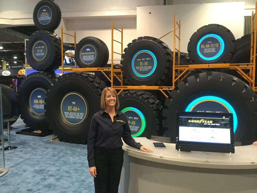 Jenifer Golba, general manager of global marketing, Goodyear, displays tires for mining machines.