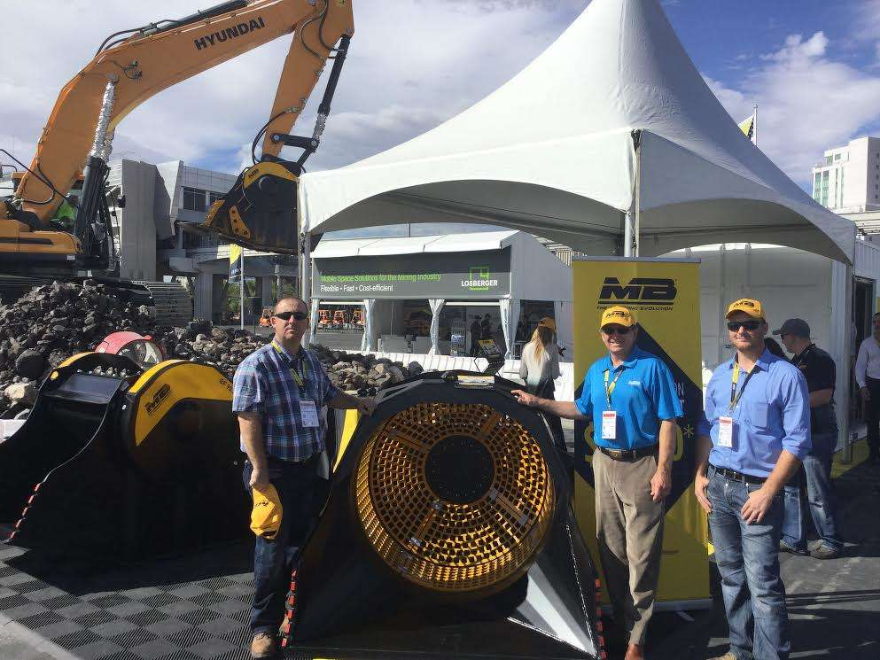 (L-R): Dominic McNamara, owner of AU Equipment, Arizona dealer of MB Crusher, and Frank Kurnik and Kyle Taylor, area managers of MB Crusher, Reno, Nev., are on hand to give live demonstrations of the crusher bucket. MB Crusher hauled in 200 tons (181 t) of rock for the demonstrations.