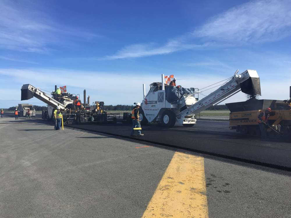 There were two paving crews with six workers on each, plus eight locally-hired truck drivers.