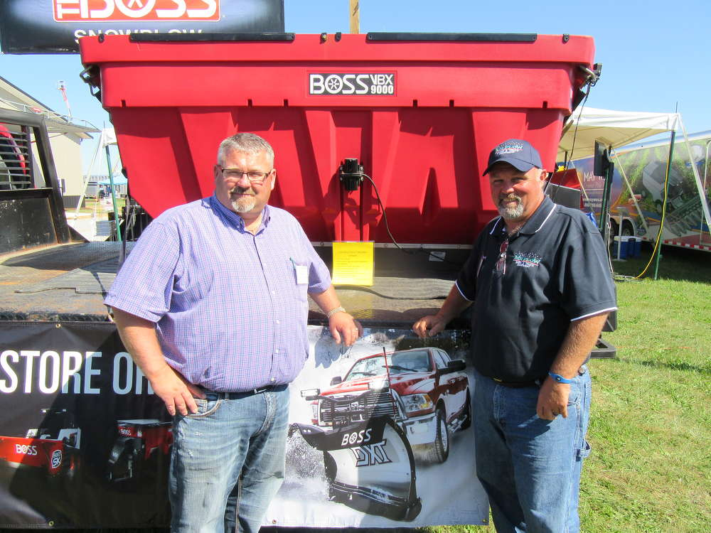 Kevin Flory (L) and Kevin Crawford, both of Mr. Plow Snow & Truck Equipment, talk about their lineup of snow plows and salt spreaders from Boss and other manufacturers.