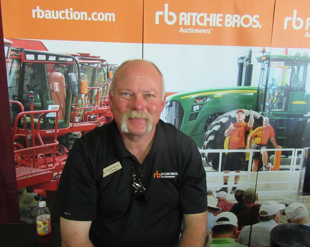 Richard Barratt of Ritchie Bros was eager to talk about upcoming auctions at the show.
