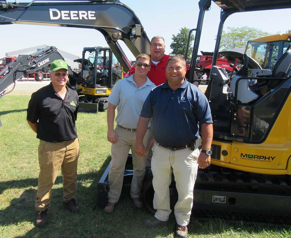 (L-R): Richard Springer of Shearer Equipment joins  Ted Crane, Brent Chauvin and Eric Bischoff, all of Murphy Tractor & Equipment, to man the John Deere Equipment display.