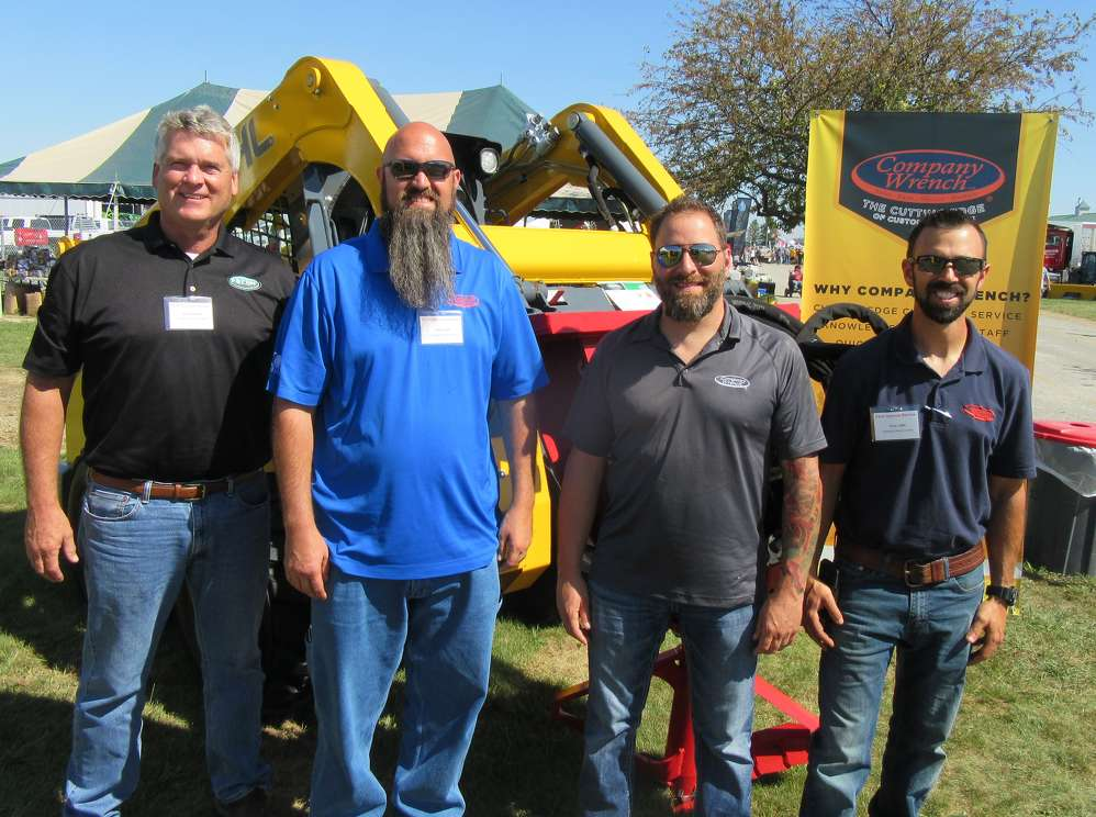 (L-R): Bob Candee of Fecon was on hand at the Company Wrench/Taylor Rental equipment display to assist Gabe Clark, Kevin Dodds and Tony Little to talk about th equipment.