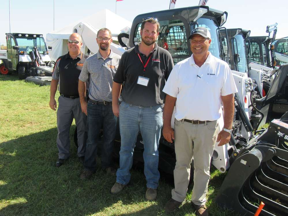 (L-R) are Tom Whitton and Travis Heim, both of Bobcat of Dayton; Adam Brush of Bobcat Enterprises; and Buzz Helser, Bobcat territory representative.