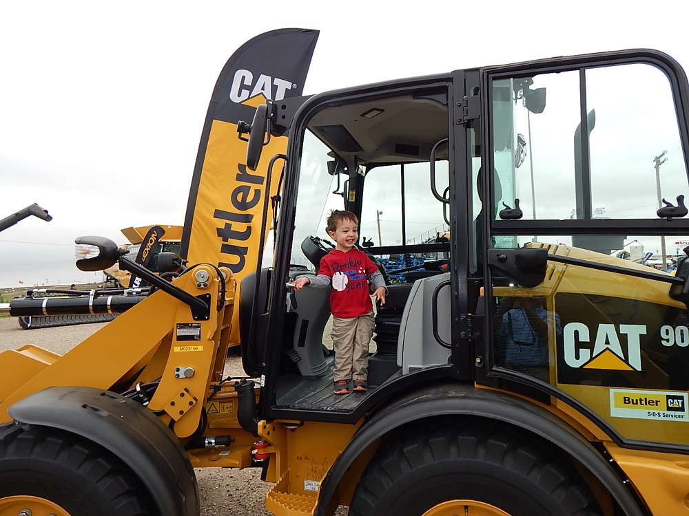 Charlie Schulz from Fargo, N.D., has a great time in this Cat 906M compact wheel loader at the Butler Machinery outdoor display area.