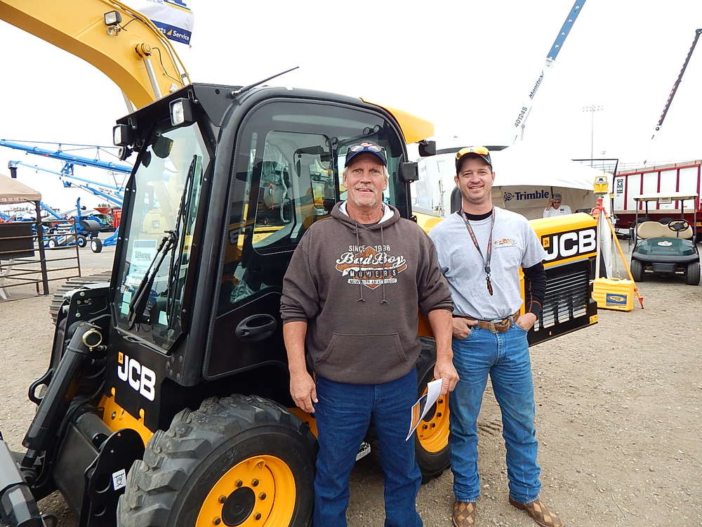 Wade Hatcher of Valley City, N.D., runs a mechanics shop and campgrounds maintenance with HJ Norman. They looked at the JCB 260 E skid steer at the General Equipment, Fargo, N.D., booth.