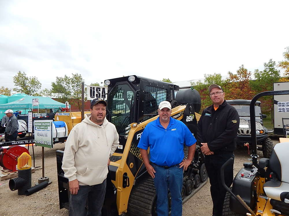 Buffalo River Sales, Glyndon Minn., which is the newest ASV Equipment dealer in northwest Minnesota, was represented at the event.  (L-R) are Lynn Stuhaug, partner and manager; Jim Haroldson, ASV regional sales manager; and Kevin Bjornson, Buffalo River salesman, with a new ASV RT-120.