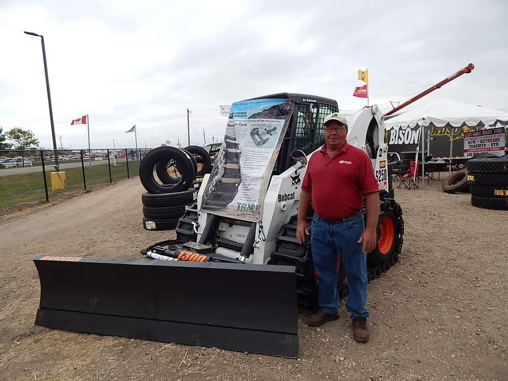 Gary Luther, Grouser marketing manager, Fargo, N.D., talks about this Grouser skid steer with a mounted snow blade and a Grouser bar track system.