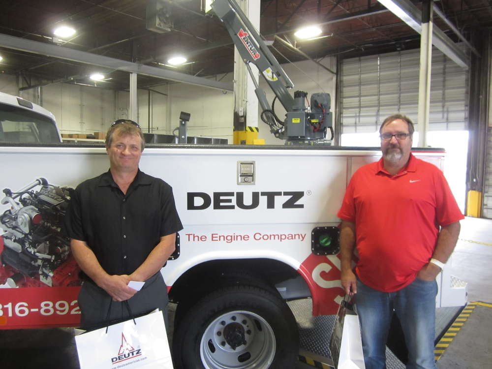 Scott Dickey (L) and Roland Hammond, both of Murphy Tractor & Equipment tour the shop area at the DEUTZ Power Center Midwest.