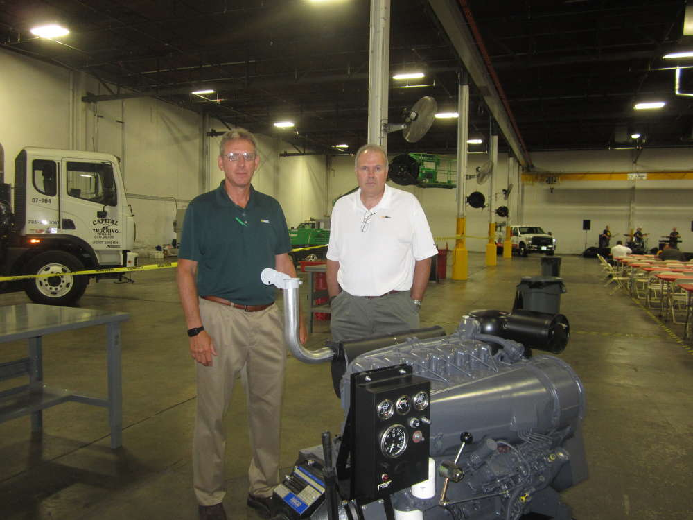 The event featured several of the Deutz exchange engines on display at the open house and taking a look are Stephen Ritter (L) and Rick Kneib, both of Altec Industries Inc., attend the event and look at the Deutz exchange engines on display.