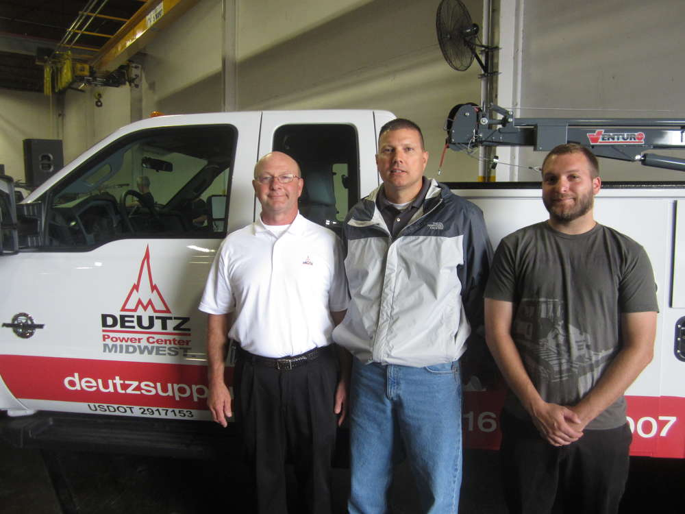 (L-R) Tim Vavricek, Deutz Power Center Midwest, gives a tour of the new facility to Mike Hink and Josh Halte, both of Road Builders Machinery And Supply Co.