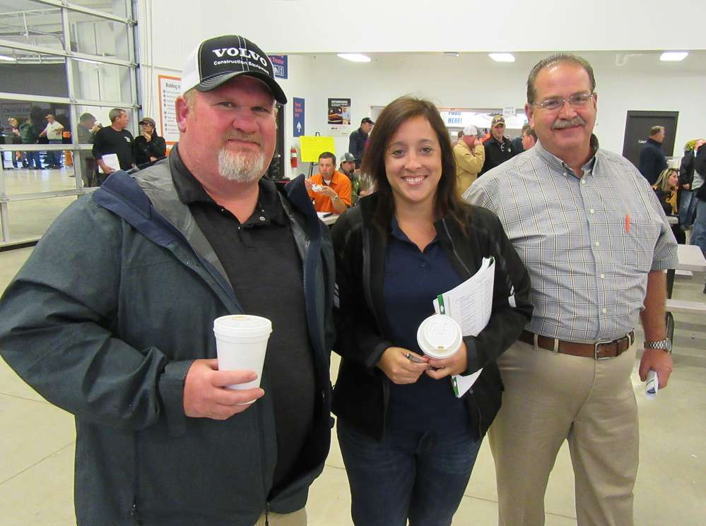 (L-R): Josh Poston, Ohio representative of Rudd Equipment Company, joins Marcela Newman and Albert Medcalf, Rudd Equipment Company, Louisville location, during the auction.