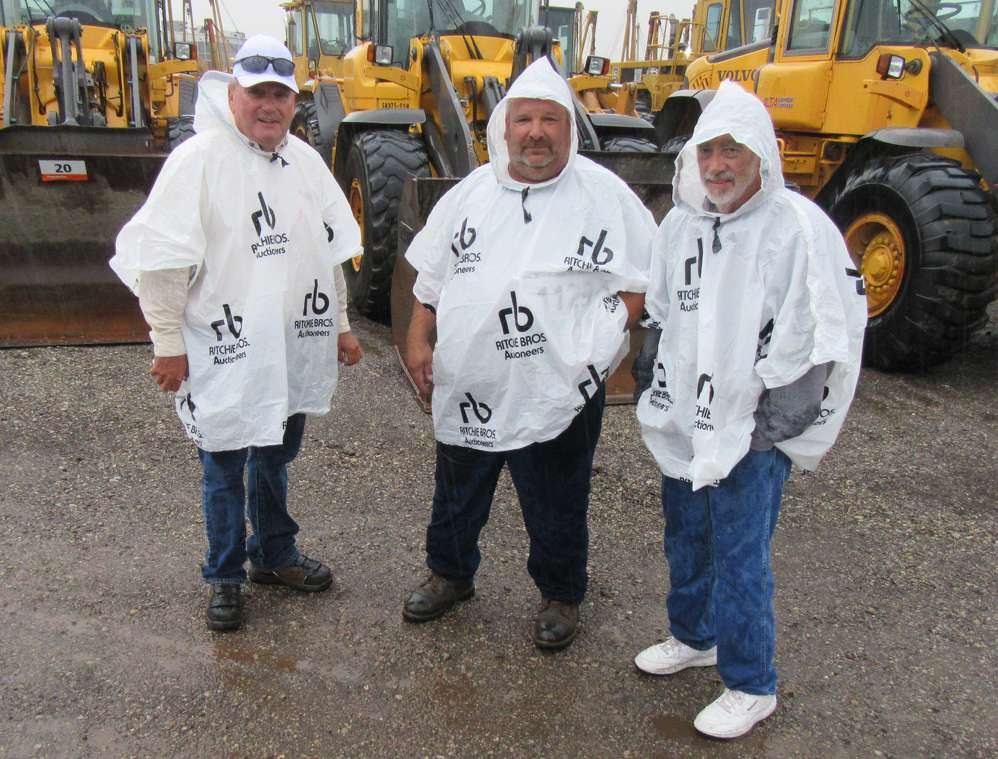 (L-R): Dan James, Larry Kane and Kipp Savage, all of J&S Maintenance, based in Zanesville, Ohio, take a closer look at the machines.