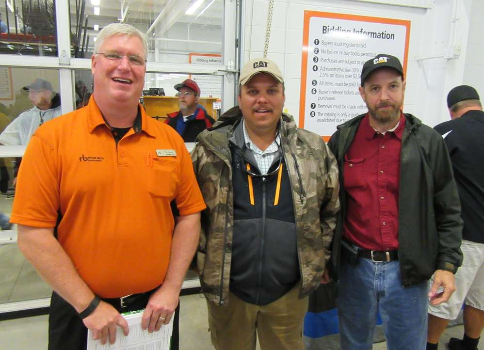 (L-R): Tim Keane, Ritchie Bros., greets Richard Pierson and John Kernan, both of Diamond Materials, Wilmington, Del.