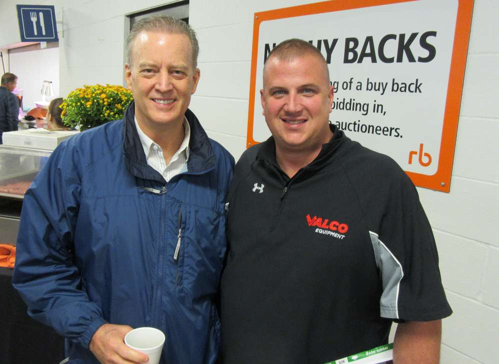 Steve Oyster (L) and Dave Maier, both of Highlift Equipment/Valco Equipment, attend the auction.