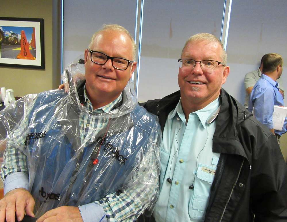 Brothers Mike Johnson (L) of Michigan CAT and Chris Johnson of Alta Equipment Company  enjoy their time at the sale.