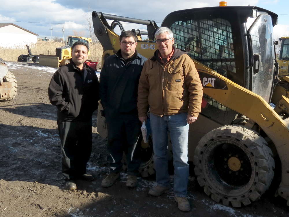 "The ""tire team"" at Oakridge Landscaping rolled out a skid steer program using Camso SKS 793S tires to solve persistent downtime problems. (L-R) are Roger Abreu of Benson Tires; Maintenance Manager Shawn Guiluppe; and Equipment Superintendent Randy Deleavey."