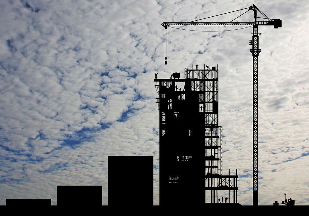 Much of the work entails arranging huge tower cranes to blow with the wind like a weather vane, putting away debris that could become projectiles, emptying out dumpsters of loose material.