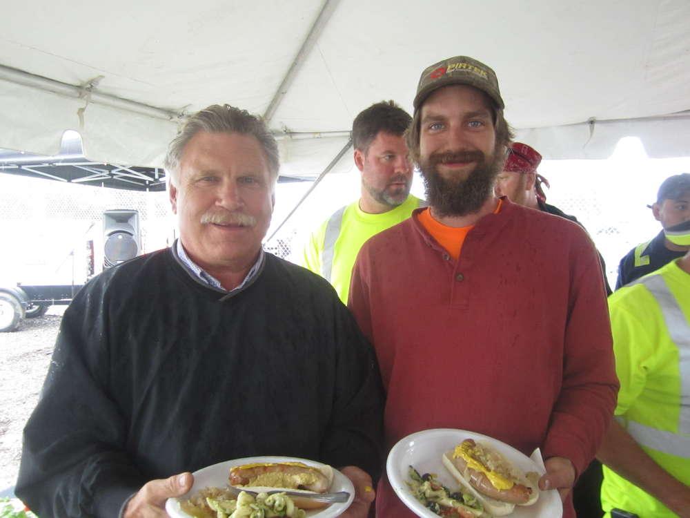 Scott Sinnett Sr. (L) and Scott Sinnett Jr., owners of Sinnett Excavating, enjoy the catered lunch.