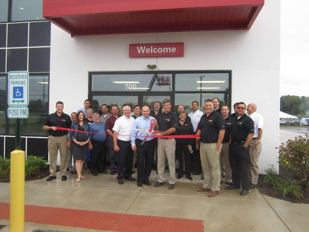 Garrett Patten, president of Patten CAT, cuts the ribbon to officially open the new Wauconda, Ill., store.