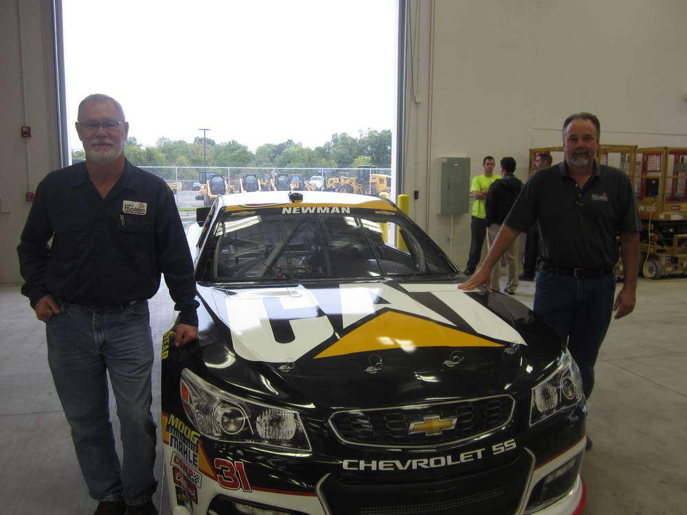 Darrell Hughes (L) and Jerry Hemmerling, both of the village of Mundelein, get a closer look at the Cat race car driven by NASCAR driver Ryan Newman.