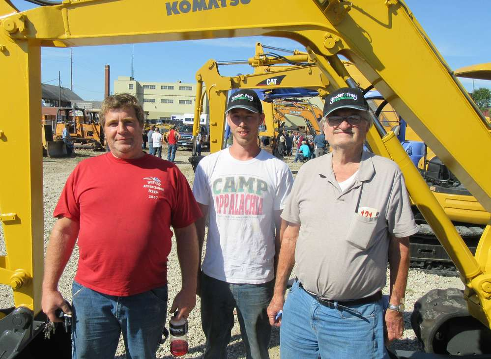 Dale Sarvey, Stuart Mettler and John Sliwinski, all of JS Northeast Company in Girard, Ohio, shop for excavators at the auction.