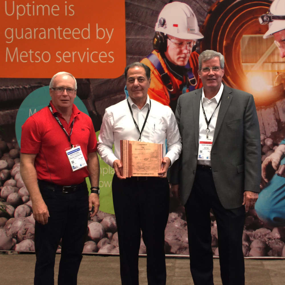 Rick Coleman (Freeport-McMoRan), João Ney Colagrossi (Metso), and Terry J. Wilkins (Metso) accept copper scroll in recognition of long-term strategic partnership at MINExpo International 2016