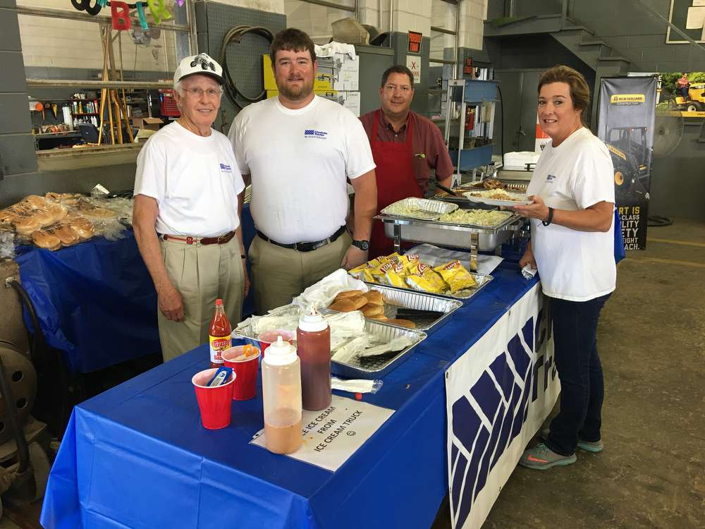 (L-R) are Bob Cockerham, founder of Charlotte Tractor Company, and Brett Cockerham, Richard Champury and Debbie Cockerham, all of Charlotte Tractor Company.