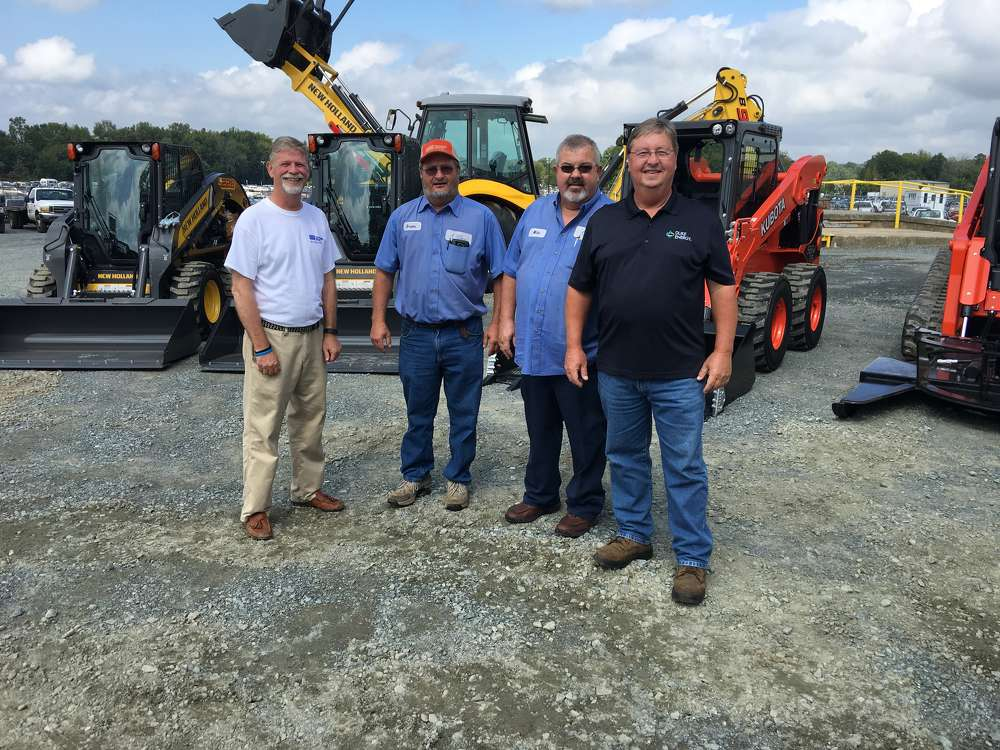 (L-R): Tim Cockerham of Charlotte Tractor Company welcomes Brooks Ferguson, Mike Dellinger and Kenny Walker, all of Duke Energy.