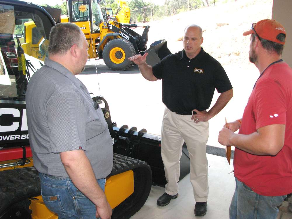 (L-R): David Nickelson, Atlanta JCB service manager; Shane Coates, JCB general manager, Savannah, Ga.; and Rick Losey, Cobb County, Ga., school board, Marietta, Ga., discuss the JCB compact track loader products.