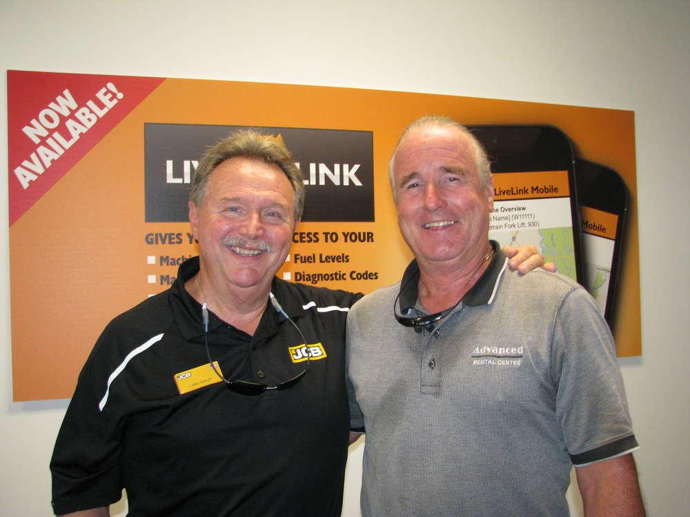 Larry Ashley (L) of JCB welcomes Gary Bonds, owner of Advanced Rental Center, Canton, Ga.