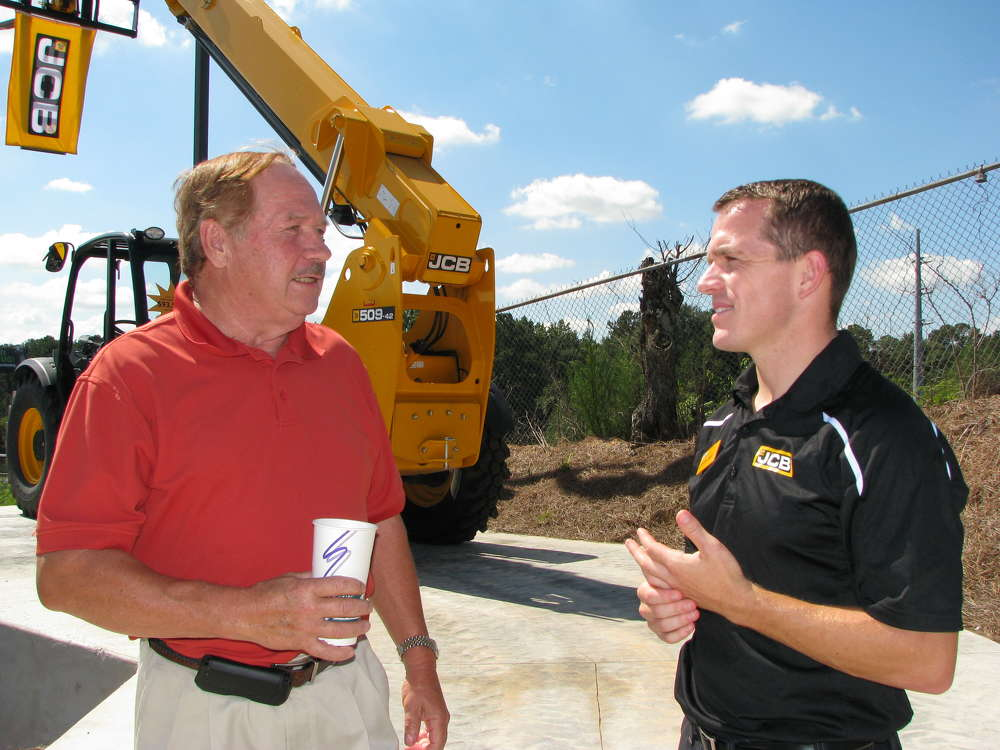 Anthony Bentley (L) of Marietta, Ga., and Pete Gallagher, JCB backhoe sales manager, Savannah, Ga., talk about the machines on display.