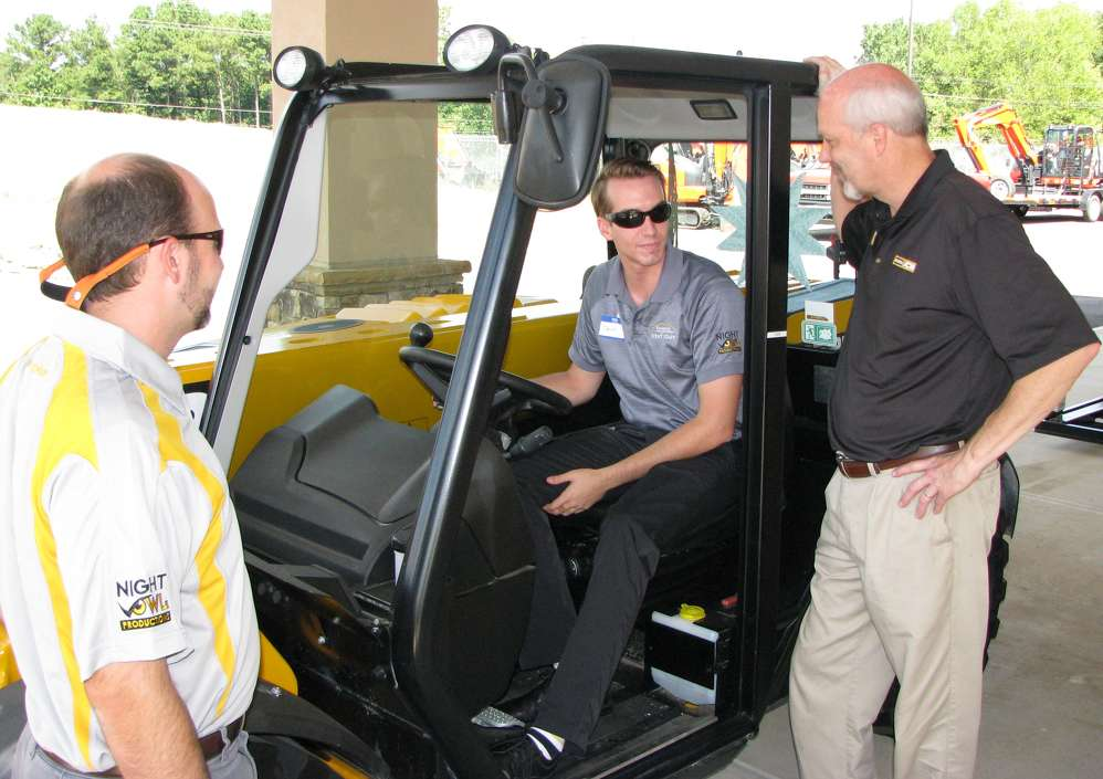 (L-R): Zack Kerns of Kennesaw State University Sports & Entertainment Park, Kennesaw, Ga., and David Bennet of the Kennesaw State University events staff, Kennesaw, Ga., receive more information about a JCB telehandler from Ken McGuffin, Atlanta JCB.