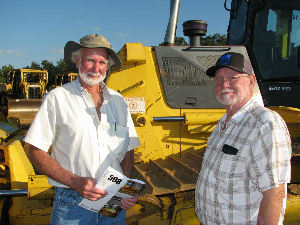 Gene Mauldin (L) of  Mauldin Excavation, Doerun, Ga., and Lester Baird, retired operator, also from Doerun, Ga., look to buy a Komatsu D61 dozer.