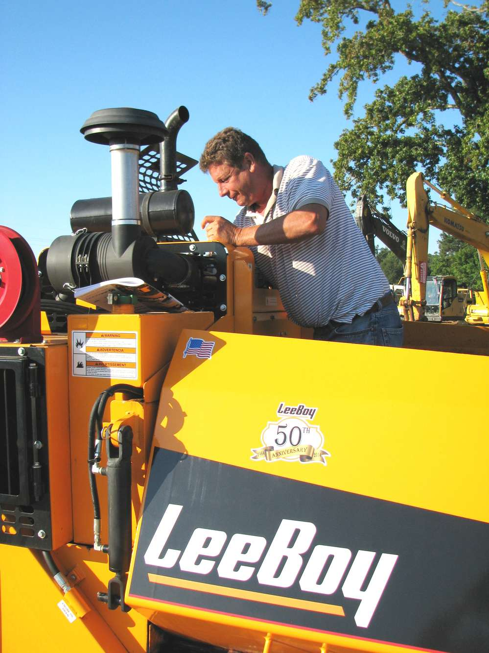 Steve Aulbach, Bituminous Contractors, St. Louis, Mo., inspects this 2015 LeeBoy 8500C.