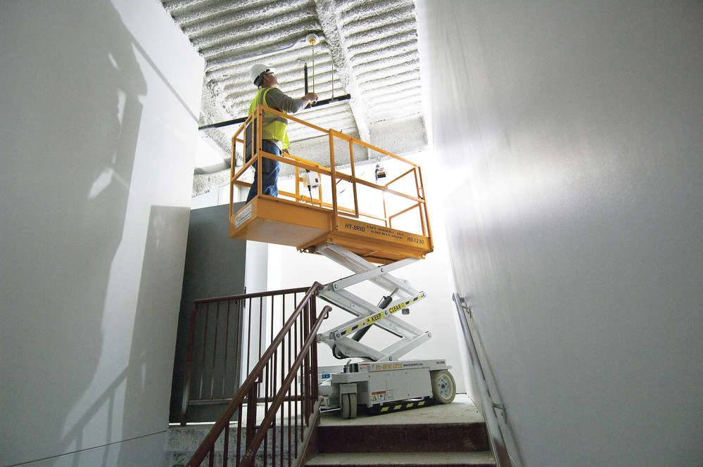 Laborers can achieve up-and-over access for a wide range of obstacles, such as stair railings, when using lifts with slide-out extensions. Ladders and scaffolding can't always access these types of obstacles without putting operators in tough — and sometimes, dangerous — situations.
