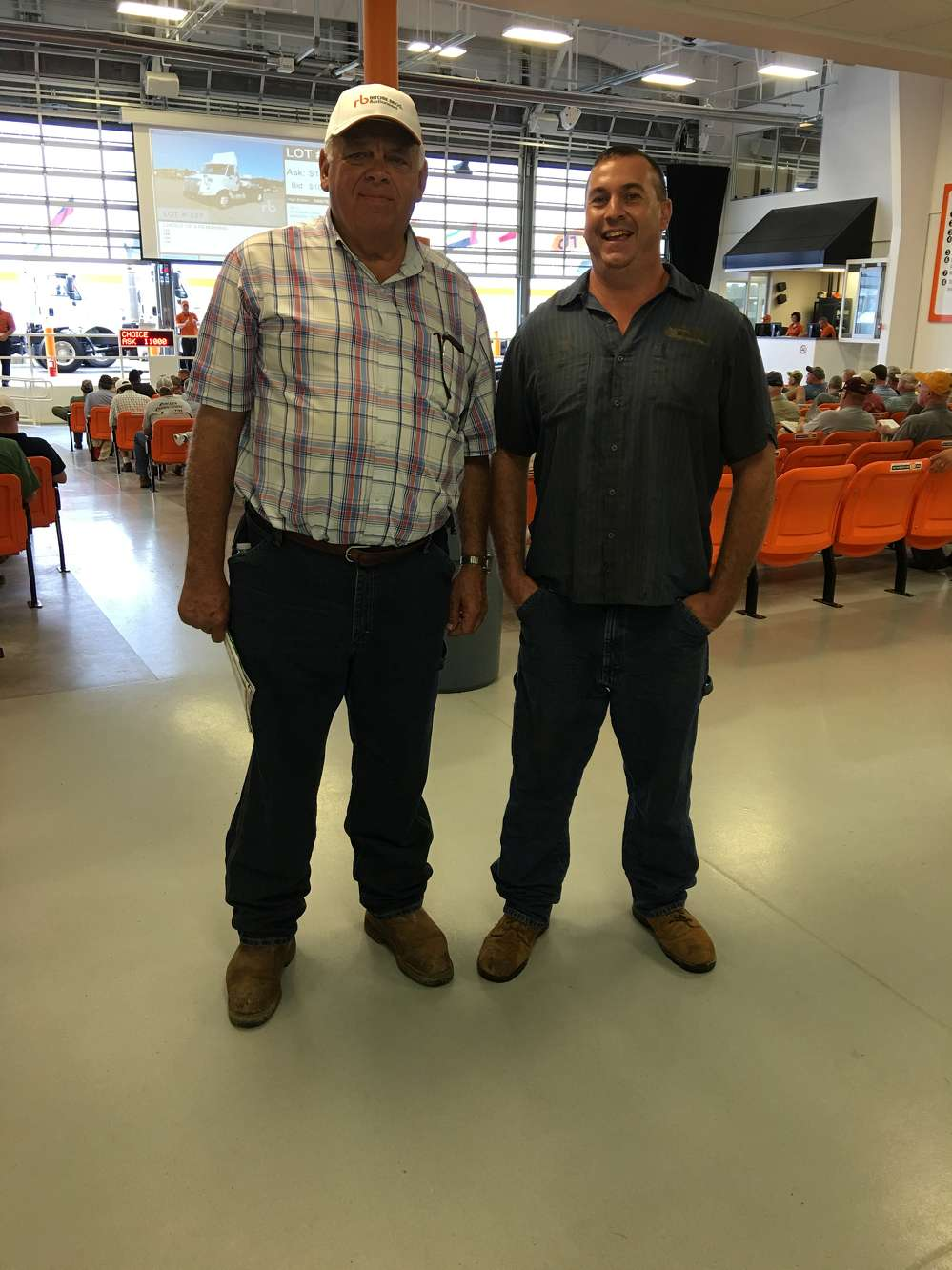 Rick Sowers of Sowers Construction Company in Mt. Airy, N.C., and John Earles of JSE Excavating in Fieldale, Va., follow the sale.