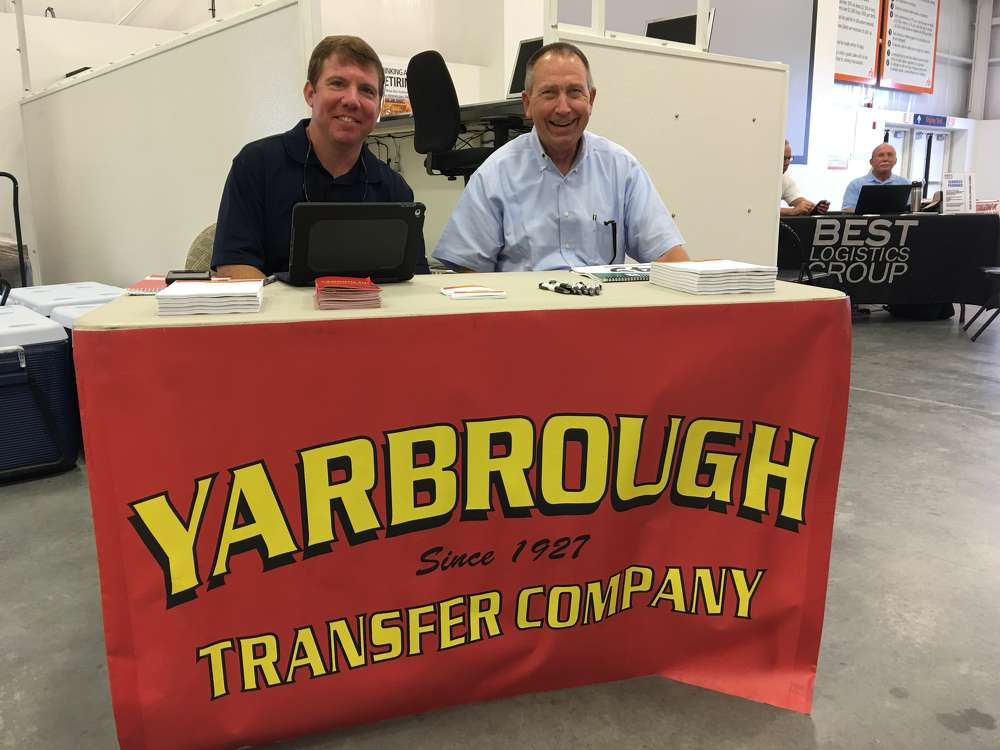 Brent Jacques (L) and Jim Yarbrough, both of Yarbrough Transfer Company, in Winston-Salem, N.C., help buyers with their transportation needs.