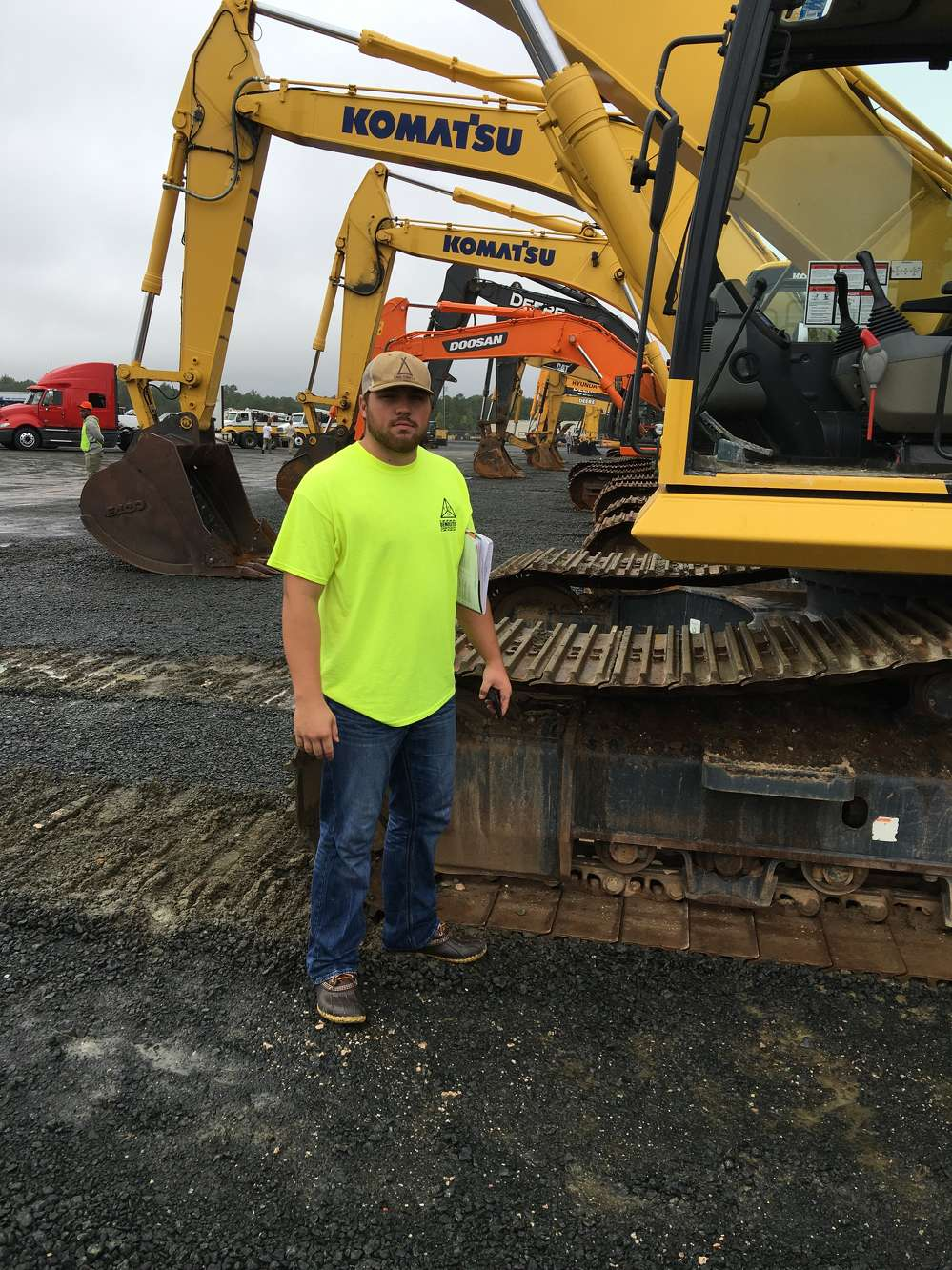 Blake Morehead of Complete Demolition Services in Carlton, Ga., looks over the Komatsu excavators.
