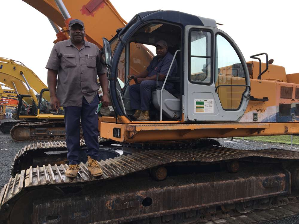 Rodney (L) and Ervin Dickerson, both of Dickerson Landscaping in Raleigh, N.C., came to the sale to buy an excavator.
